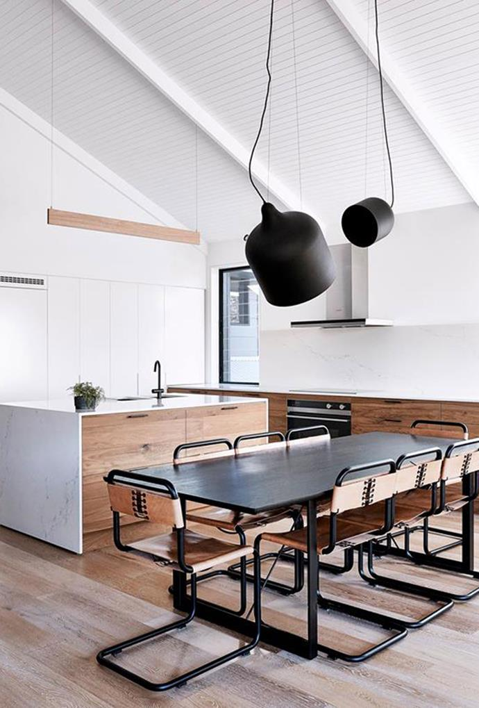 Statement black pendant lights create a classic focal point in this refined rustic style kitchen. *Photo: Terence Chin*