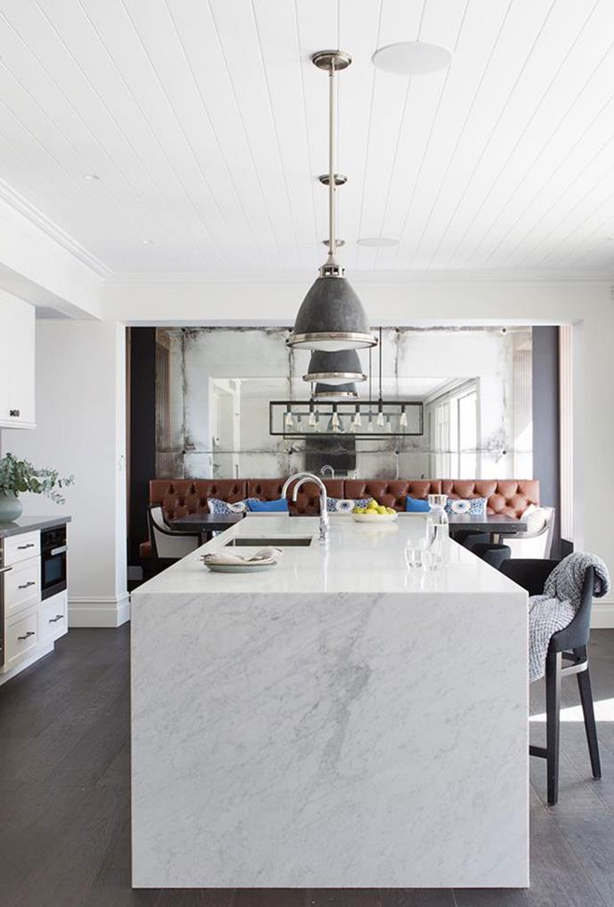 "Large industrial pendant lights create a sense of symmetry and amplify light in the kitchen of this [Sydney 1870's heritage](https://www.homestolove.com.au/sydney-1870s-heritage-house-restoration-6030|target=""_blank"") abode. *Photo: Simon Whitbread*"