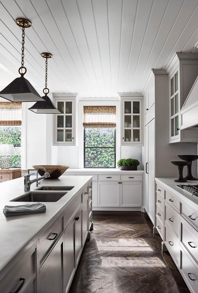 """Custom industrial style pendant lights serve up family-sized sophistication in this classic timber detailed kitchen by [Thomas Hamel & Associates](https://thomashamel.com/