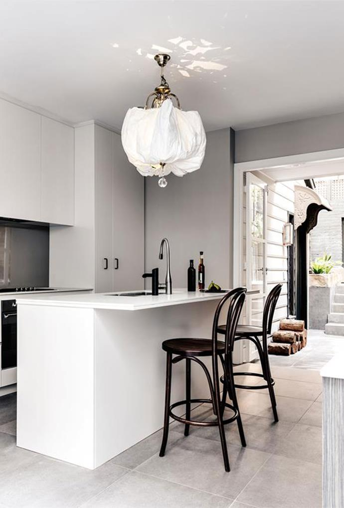 "A vintage linen pendant light channels the heritage charm of this [sandstone Sydney terrace](https://www.homestolove.com.au/redesign-of-a-heritage-sandstone-sydney-terrace-6317|target=""_blank""), which has been redesigned to feature contemporary aesthetics."