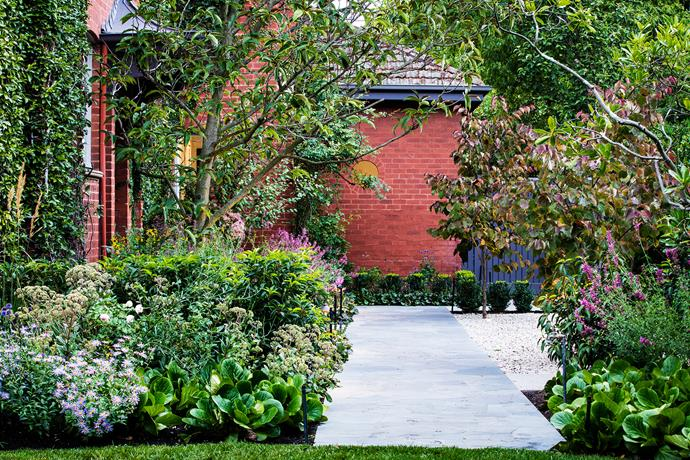 The front entrance (seen here from the side) contains classic elements befitting a Federation home. The gravel courtyard and Buxus (box) hedging add formality, in contrast to the looser look of the perennials.