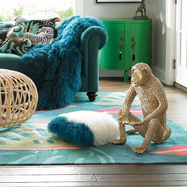 Mongolian Fur Pillow, $133, and Rattan Monkey, $133.