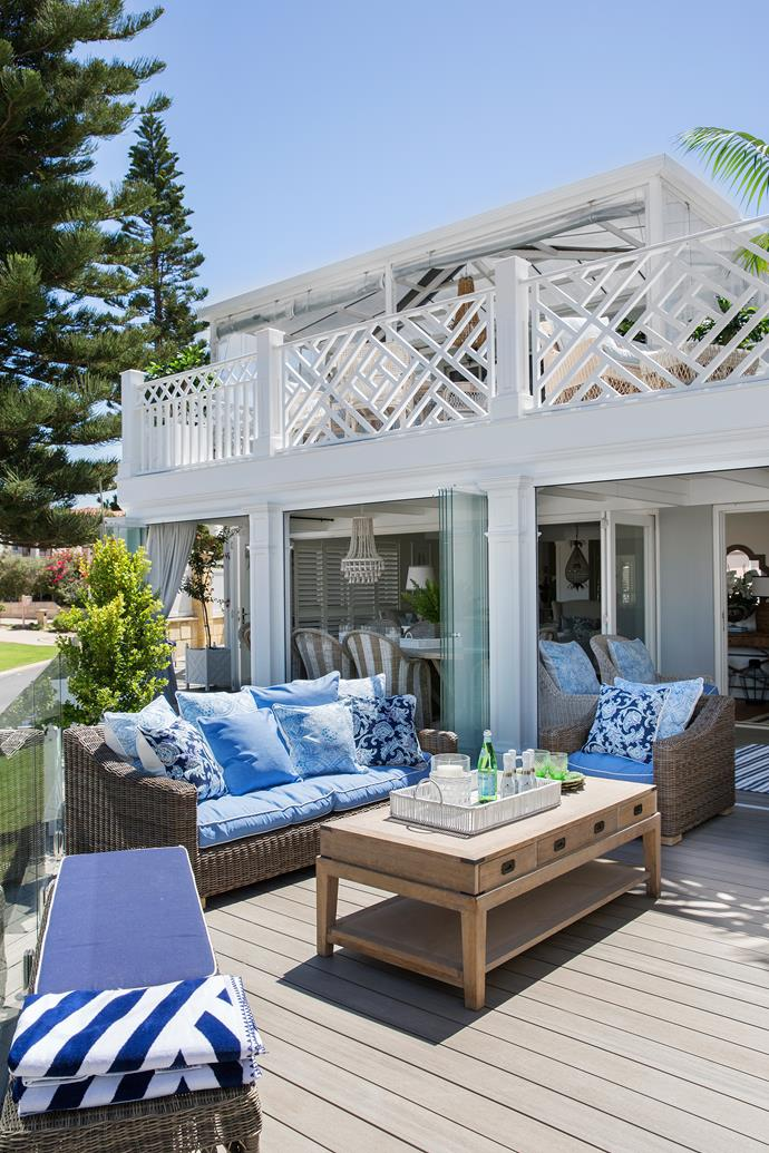 Blue and white soft furnishings complement this Hamptons style home exterior.