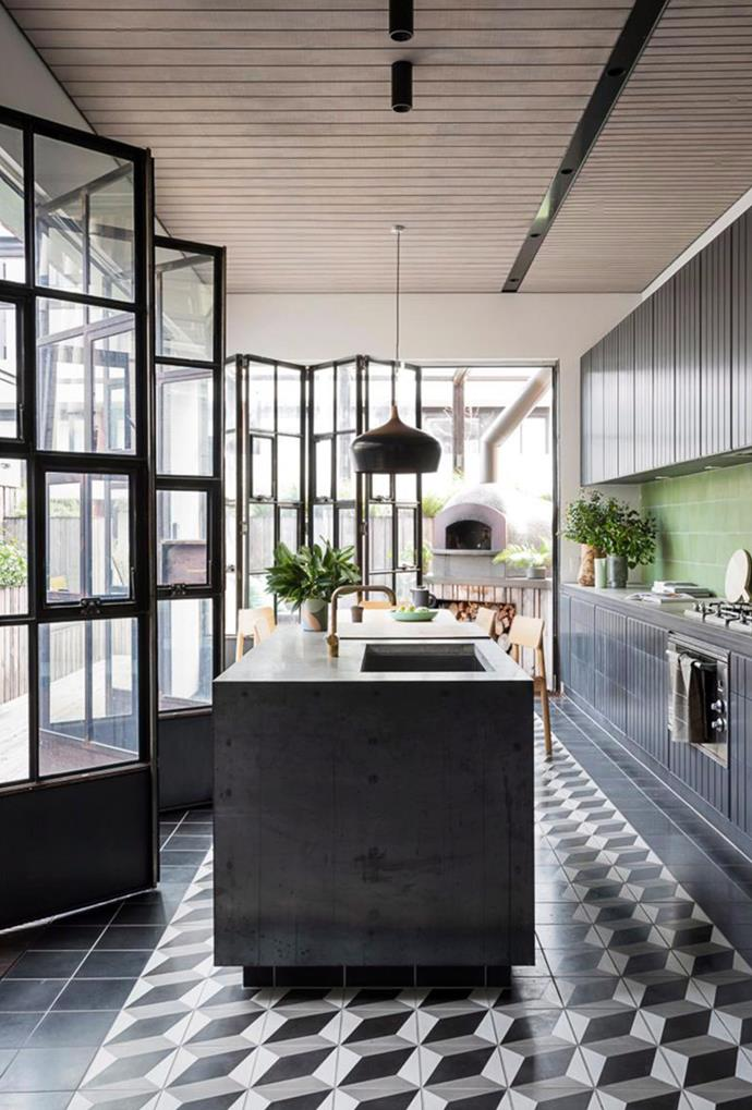 """**Back to black:** Kitchen colour palettes are a lot darker and more mysterious than previous years. In 2018, kitchens are moving away from brighter and lighter interiors in favour of a much moodier style. [Black kitchens](https://www.homestolove.com.au/black-kitchens-with-contemporary-appeal-2777 target=""""_blank"""") with dark cabinetry and floor tiles give the heart of the home a polished and contemporary feel. For a subtle take on the trend, try investing in black appliances. *Photography: Martina Gemmola / Bauer Syndication*"""
