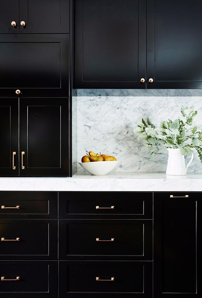 **Handles 2.0:** Push-to-close drawers and cupboards resulted in san-handle kitchens in recent year but now they're back on-trend with gold accents and oversized designs set to rule this year. Replacing simple stainless-steel handles with beautiful, ornate versions can give a space instant character. *Photography: John Paul Urizar / Bauer Syndication*