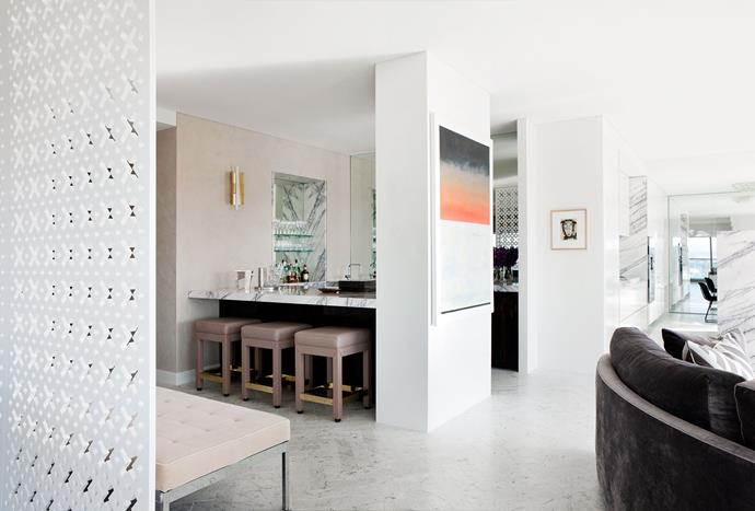 Bar stools designed by David Hicks with joinery in ebony macassar veneer from George Fethers. Vintage Gio Ponti brass wall sconce. Artworks by Bruno Leti (left) and Murray Walker (right). Walls in honed New York marble from LaPege or painted in Dulux 'Natural White'.