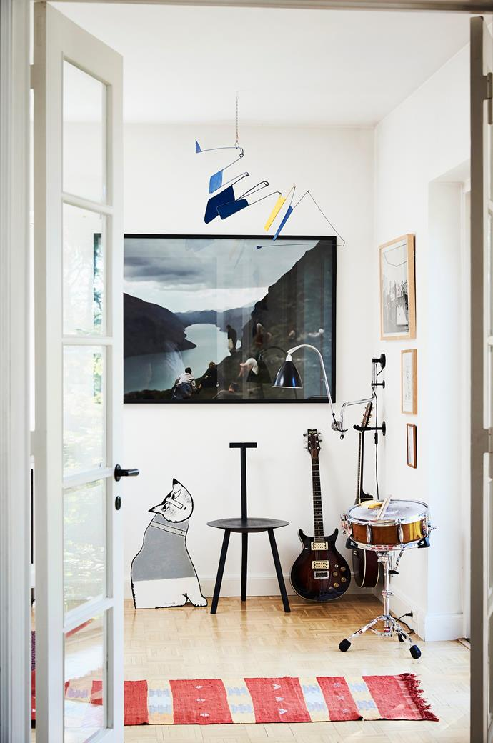 Thomas plays guitar and bass and his son the drums. The Spade chair is designed by Faye Toogood. Artworks include the cat by the Dutch Cobra artist Corneille, photography by Ebbe Stub Wittrup and a mobile by Ib Geertsen.