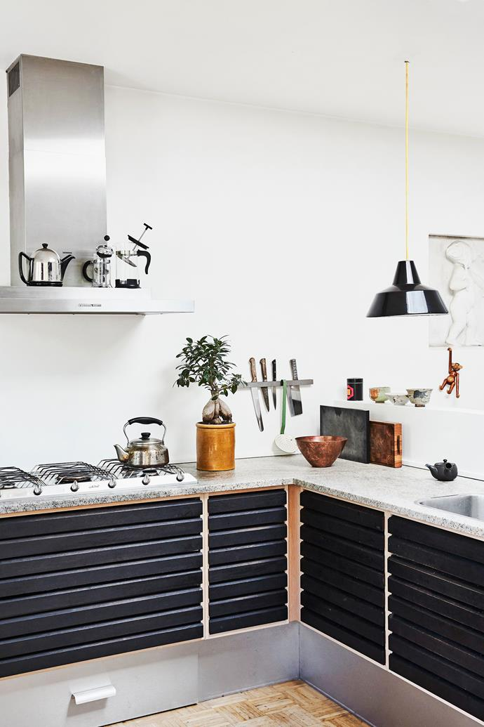 The open kitchen, with stone countertop, is from Uno Form. The tea caddies and ceramics are from Sing Tea House in Copenhagen.
