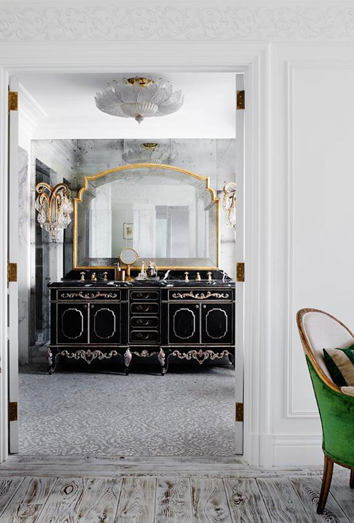 "The master ensuite of this [Italiante mansion](https://www.homestolove.com.au/italianate-mansion-in-sydney-by-dylan-farrell-design-5343|target=""_blank"") in Sydney features a French 1940s crystal and glit chandelier, together with a custom vanity and stone and concrete floors. *Photo: Prue Ruscoe*"
