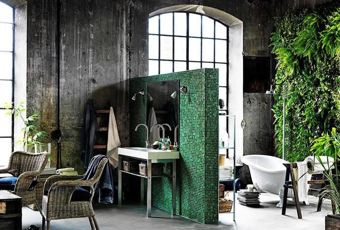"An [urban bathroom](https://www.homestolove.com.au/urban-jungle-bathroom-4799|target=""_blank"") that includes a blade wall covered in green mosaic tiles, a lush vertical garden, free-standing bathtub and floor-mounted rainshower boats luxury while pushing the boundaries."