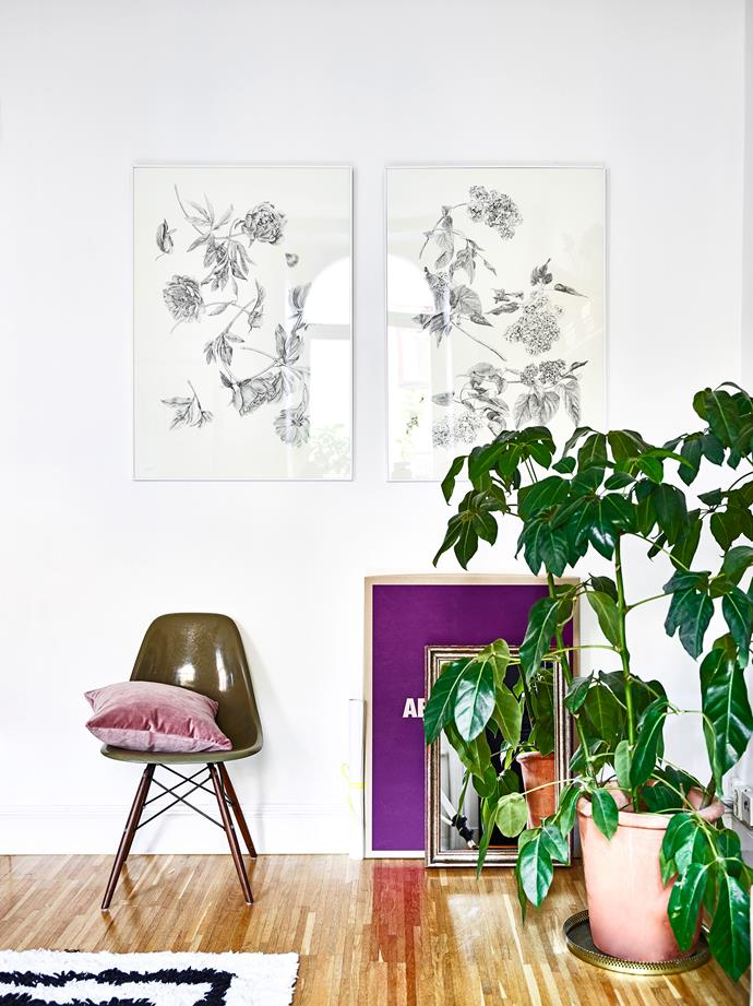 Two illustrations by Jonna Fransson – Peonies and Lilacs – are displayed in a separate corner of her living room, along with an original Eames chair from the 1950s. The dusty pink cushion is MeliMeli.