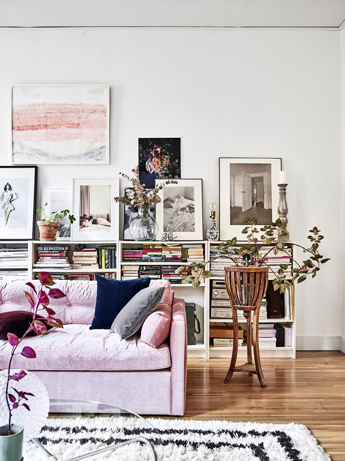 Amelia's grandmother, Gunny Widell, created the pink and grey artwork in the living area from her hospital bed before she passed away – it was an existing picture that she painted over with whatever she had on hand, including mascara and lipstick. Behind the couch, Ikea Billy bookcases house books, photos, artworks and small decorative items.
