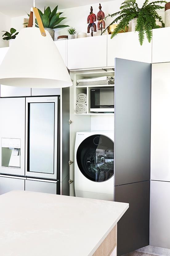 The kitchen features a clever hidden European laundry.