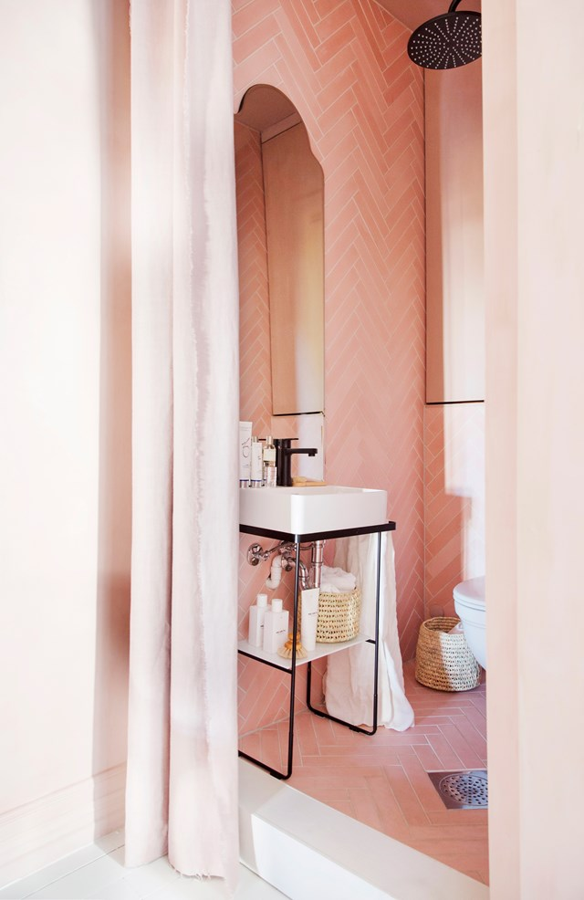 Forget a splash of pink, this bathroom has been dressed head-to-toe in the hero hue and we're not complaining! Pink herringbone tiles, powder pink walls and a complementary shower curtain combine to create the prettiest shower nook we've ever seen. Photo: *real living*