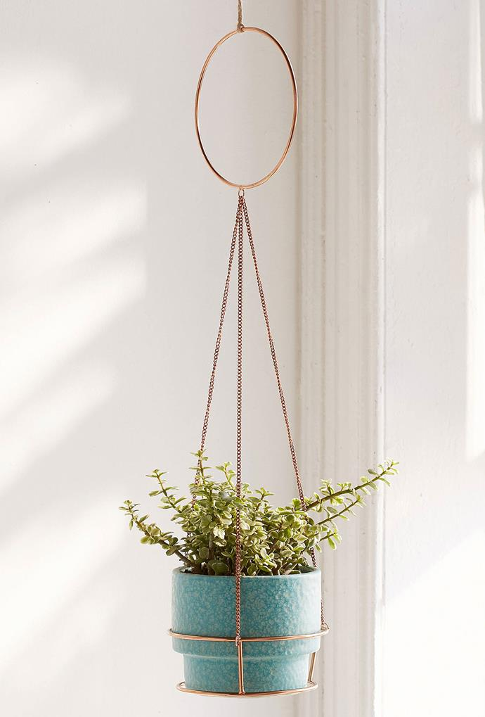 "Metal Circle Hanging Planter, $18, from [Urban Outfitters](https://www.urbanoutfitters.com/shop/metal-circle-hanging-planter?category=apartment-room-decor&color=028|target=""_blank"")."