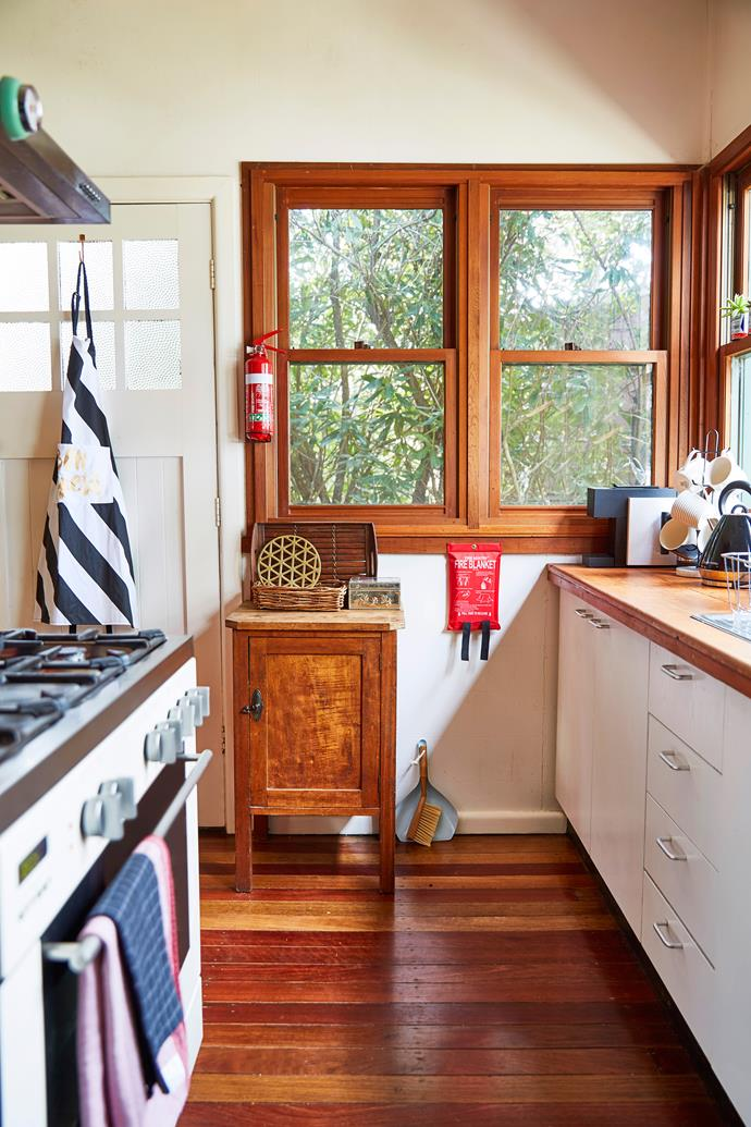 This galley style kitchen has a charming country feel.