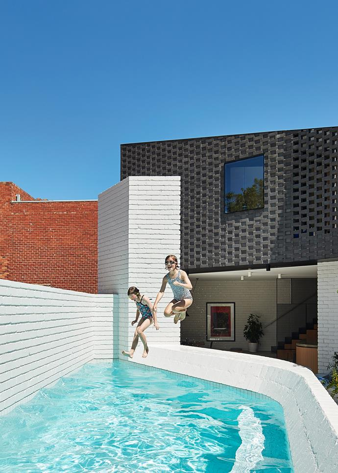 Nicole and Antony's daughters love that their backyard has a pool! The bricks used for the pool fence and lower part of the extension and courtyard are recycled, and painted with Dulux Grey Pebble Half.