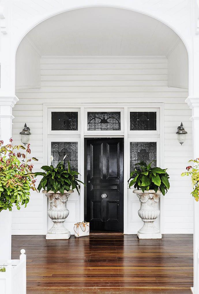 "The front door of this [classic Queenslander home](https://www.homestolove.com.au/classic-queenslander-updated-for-family-living-2577|target=""_blank"") has been painted black, emphasising the surrounding stained glass of this heritage property."