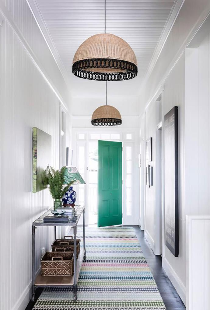 "An emerald coloured door is reminiscent of the interior scheme in this [Queenslander home](https://www.homestolove.com.au/queenslander-renovation-and-extension-5965|target=""_blank"") located in Brisbane's south-west, where pops of green and blue hues are implemented to create a warm and welcoming environment for guests."