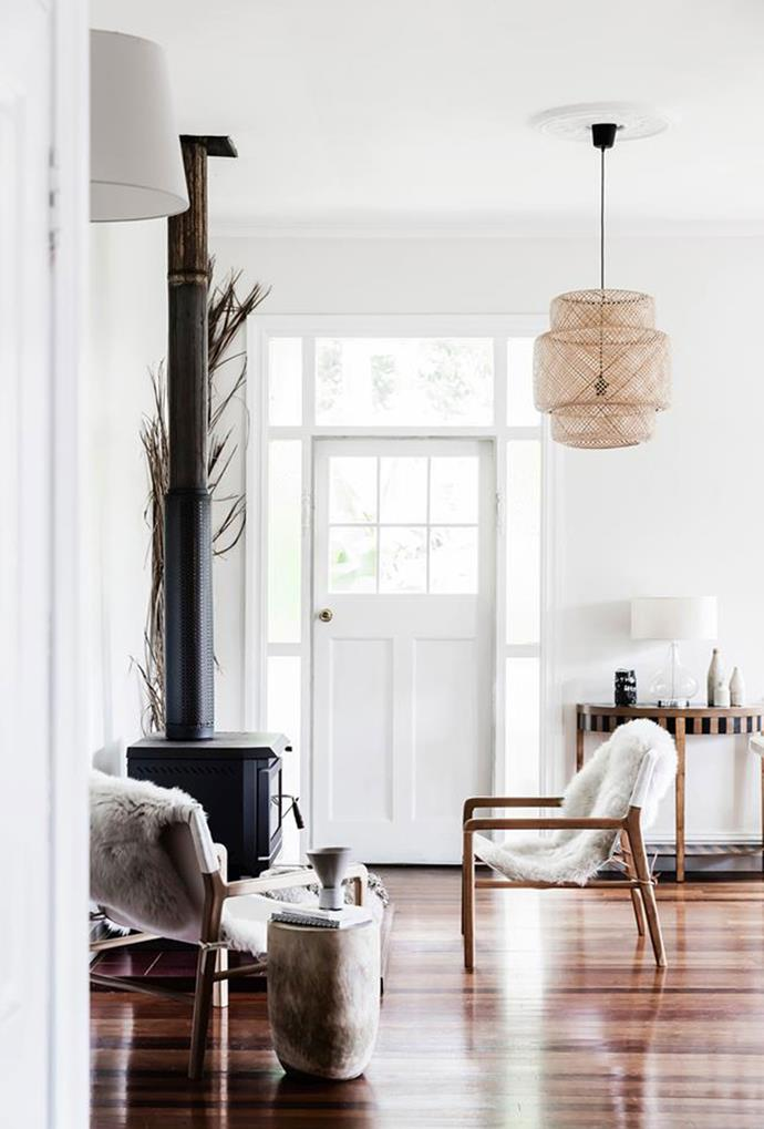 """A refined white door is indicative of the neutral minimalist palette inside this [Byron Bay cottage](https://www.homestolove.com.au/minimalist-cottage-in-byron-bay-5881