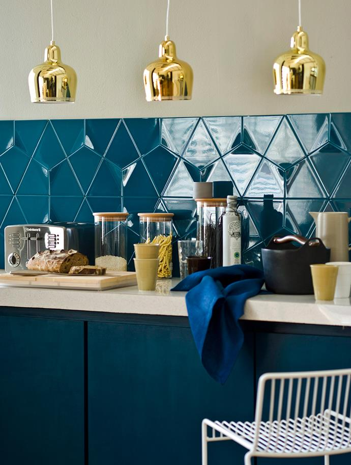 """Don't be afraid to mix and match, juxtaposing matte surfaces with high-gloss or metallic finishes. The contrast adds a modern feel to any space. If you've living with little ones, opt for higher positioned gloss finishes such as kitchen pendant lights to avoid messy fingerprints. Matte cabinets and doors mean small hands are free to explore and you'll have less to wipe down! *Photography: Maree Homer / bauersyndication.com.au* <br><br> *Brought to you by [Laminex](http://www.laminex.com.au/ target=""""_blank"""" rel=""""nofollow"""")*"""