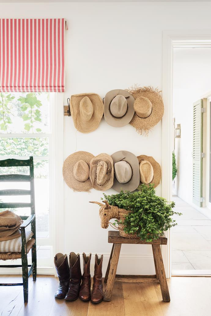 Hats live on the rack by the door. Ivy always spills from the raffia donkey pot.
