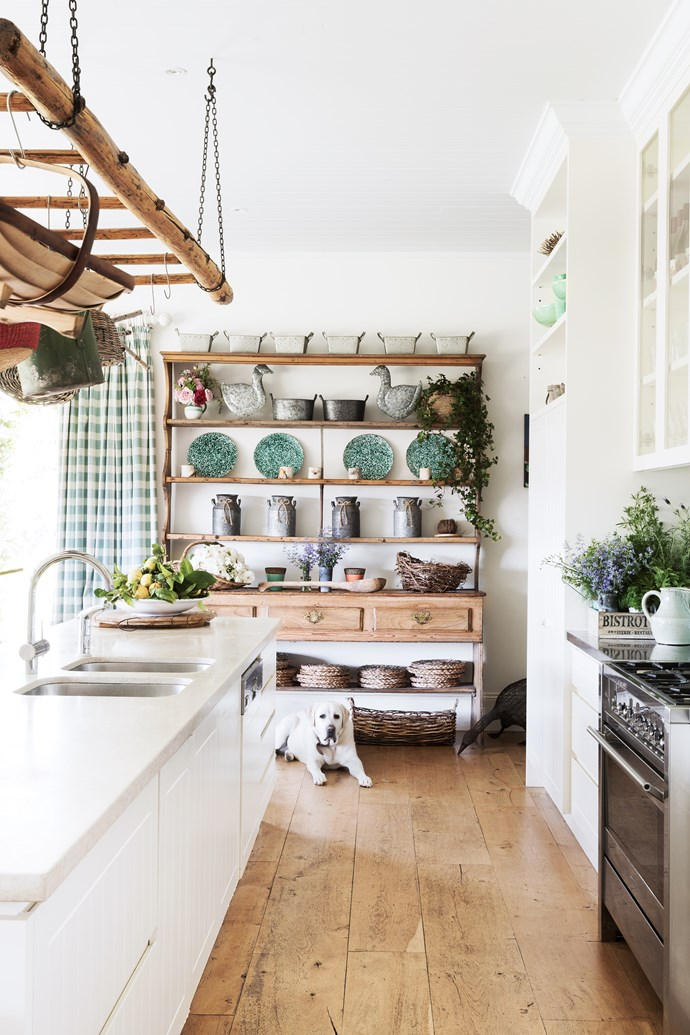 The suspended ladder is a vintage piece and the dresser came from Miles Boville Antiques years ago. Green splatter plates and kitchen stools, Market Imports. Metal geese from Provincial Home Living, one of Sam's favourite stores.