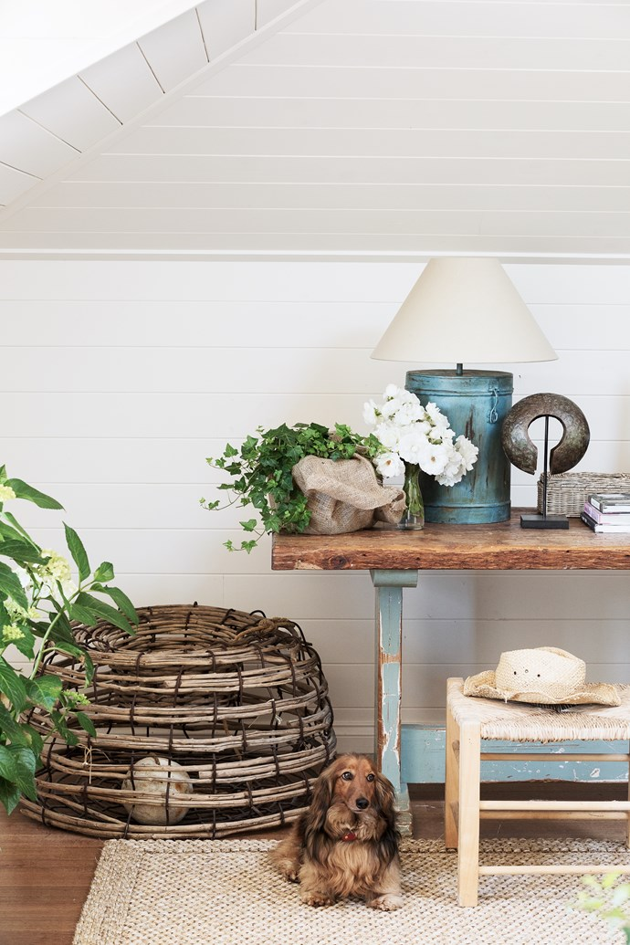 Guests love staying in this country-inspired space, surrounded by curiosities and plants. It also has a Juliet balcony. The oyster fishing basket and tin lamp bases are from a local antique dealer. Barnaby likes the sisal rug.