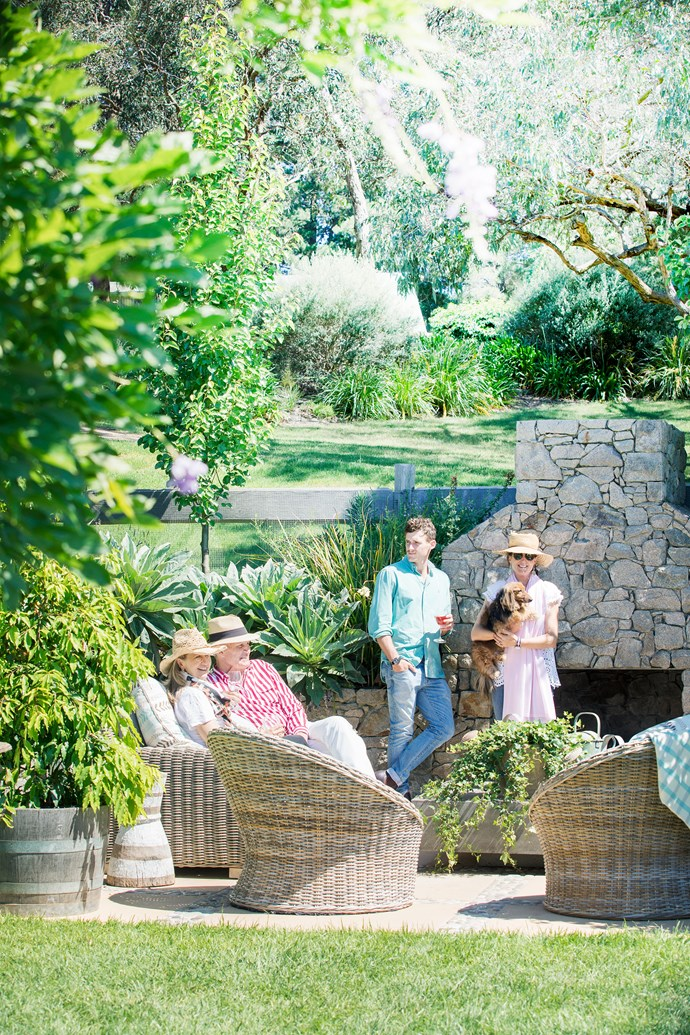 """In summer the family often eats down at the poolhouse, either inside with the doors open or out on the terrace. """"It's a beautiful space to spend time in,"""" says Sam. """"We have barbecues and salads with herbs and vegies from the garden, cheese and fruit, surrounded by flowers and ivy."""""""