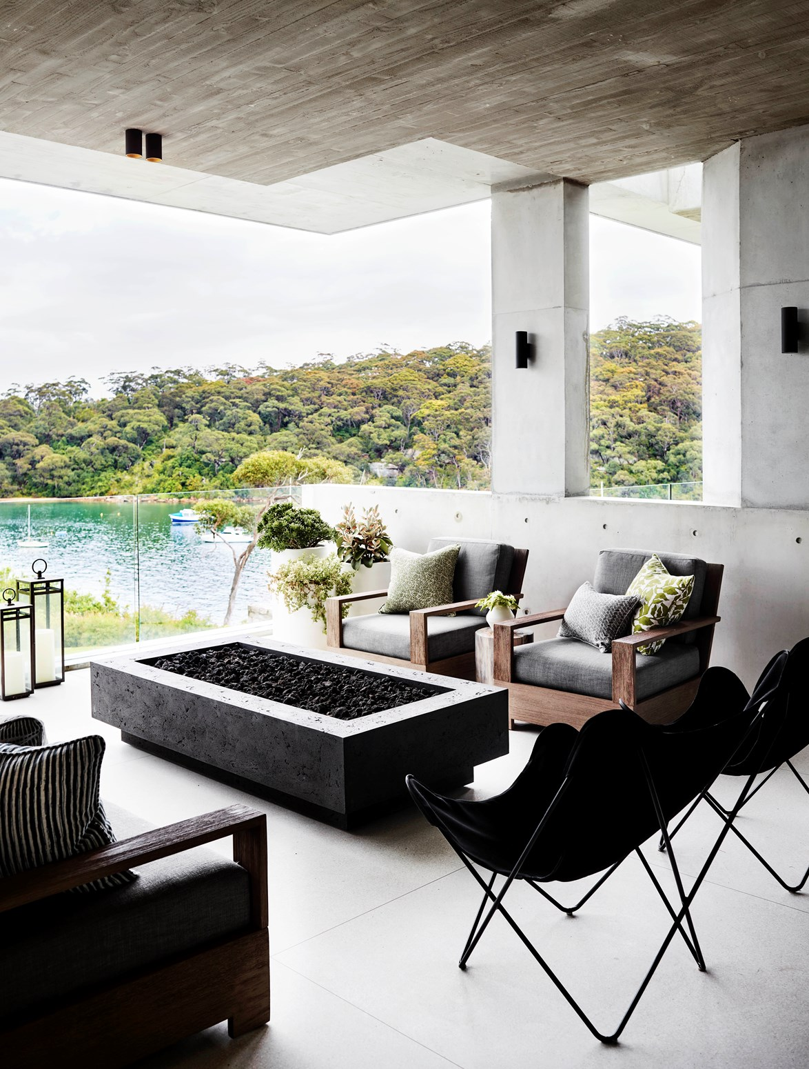 Having a fire pit doesn't need to be an eyesore. Minimalist designs in concrete, like this one in a Sydney home, blend into the decor when not in use. *Photo: Anson Smart*