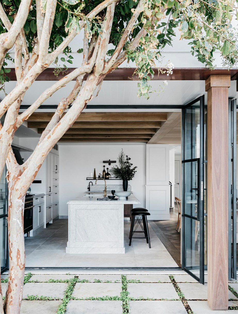 """Exposed timber beams, stone flooring and a dining room laid with parquetry all essential ingredients for a luxurious French provincial kitchen. Maintaining a connection to the outdoors – where fresh produce is but a few steps away – is also essential for evoking the sense of simple, French provincial living. This kitchen Won Best Residential Interior in the [Belle Coco Republic Design Awards 2018](https://www.homestolove.com.au/belle-coco-republic-interior-design-awards-2018-winners-6717