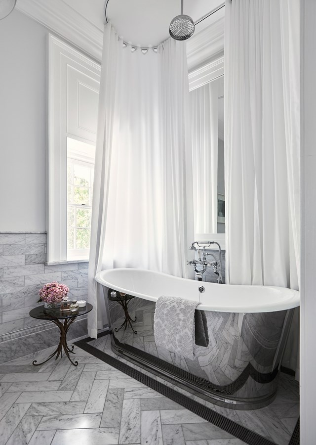 """Custom chrome finishing make this tub the shining glory of this bathroom in a [restored historic Sydney home](https://www.homestolove.com.au/restoration-of-a-historic-sydney-home-6524
