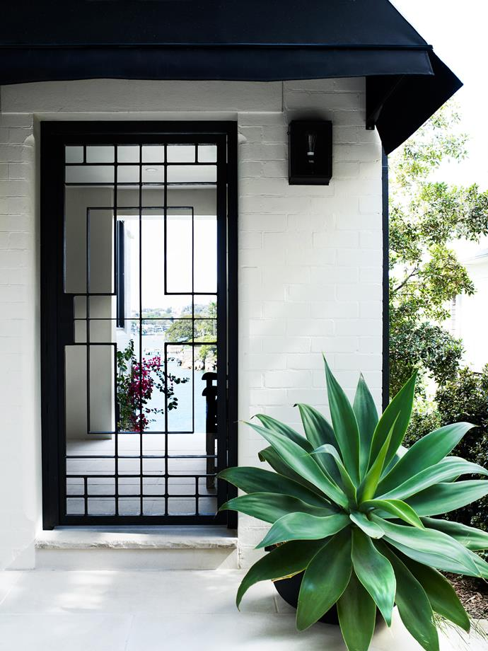 The entry has a custom-made gate and new canopy. Outdoor light from Dunlin Home.
