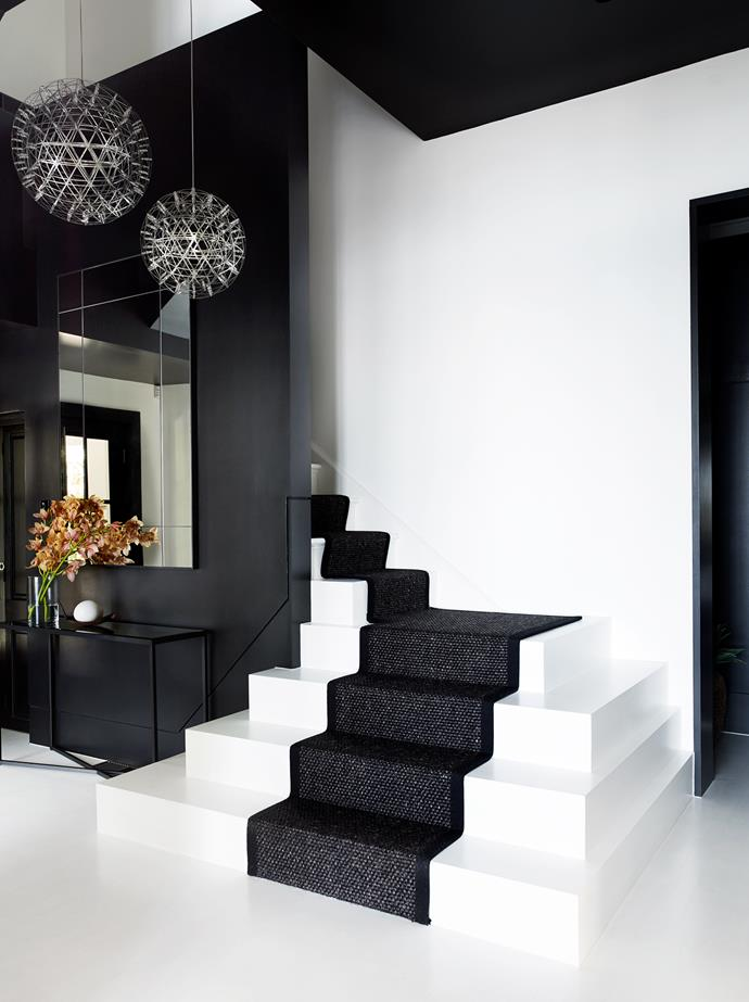 The existing staircase was retained but opened up and turned around at the bottom. The original balustradehas been boxed in with new joinery. Moooi 'Raimond' pendant lights from Space. Mirror from MCM House.