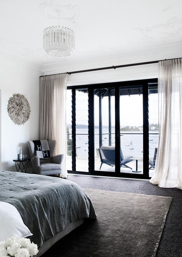 The main bedroom is oriented towards the view. Bed and Italian spread from Analu. Chair from Revival, Milton.