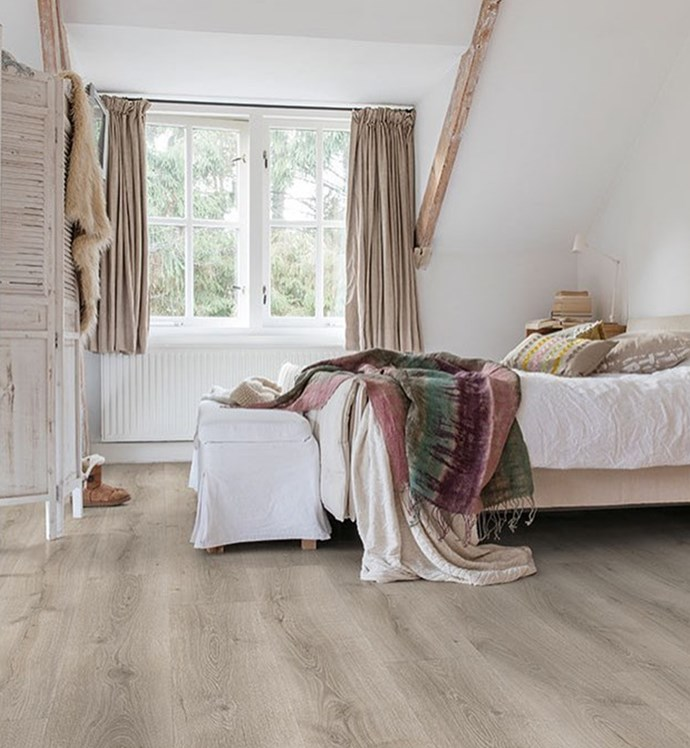 """White walls and light wooden flooring create a natural and spacious feel in small bedrooms. [**Quick-Step**](https://www.quick-step.com.au/en-au/find-your-floor?page=1&page_size=20 target=""""_blank"""" rel=""""nofollow"""") offers a wide range of easy-to-install laminate floorings that combine the look of real timber and practical benefits of laminate. *Image: supplied*"""