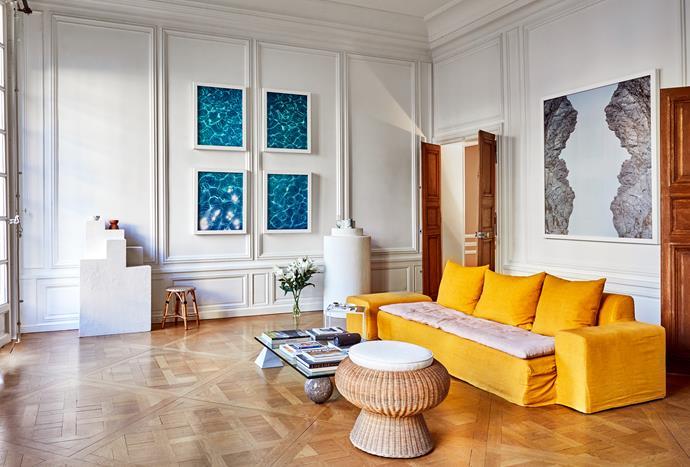 Turmeric sofa bought in Paris. Rattan stool from Paul Bert Serpette.