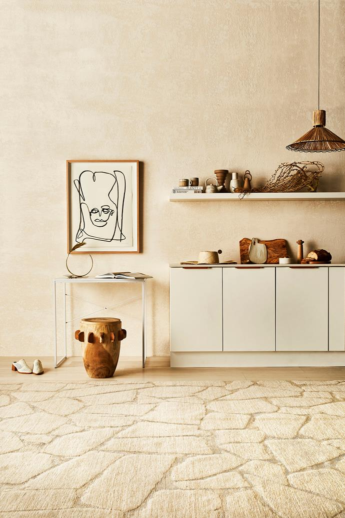 A neutral colour scheme and natural finishes creates a cohesive look in this earthy kitchen. Photo: Kristina Soljo | Styling: Kerrie-ann Jones