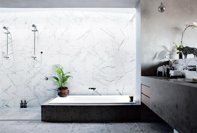 Subtle shadings of marble and tinted stucco make for a calm environment in the main ensuite of this Riverside home in Freemantle. A double shower, together with a large bath, set up the perfect area for relaxation. *Photo: Angelita Bonetti*