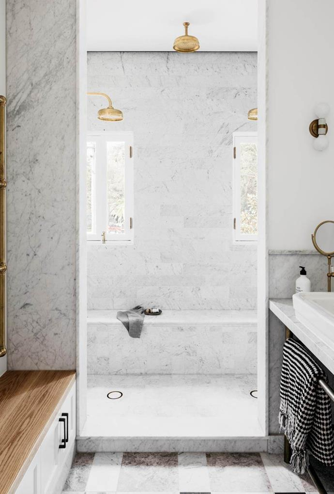 "Marble walls and floors, together with two gold shower heads, create a luxurious aesthetic in the bathroom of this [Palm Beach home](https://www.homestolove.com.au/palm-beach-house-by-alexander-and-co-6499|target=""_blank""). *Photo: Felix Forrest*"