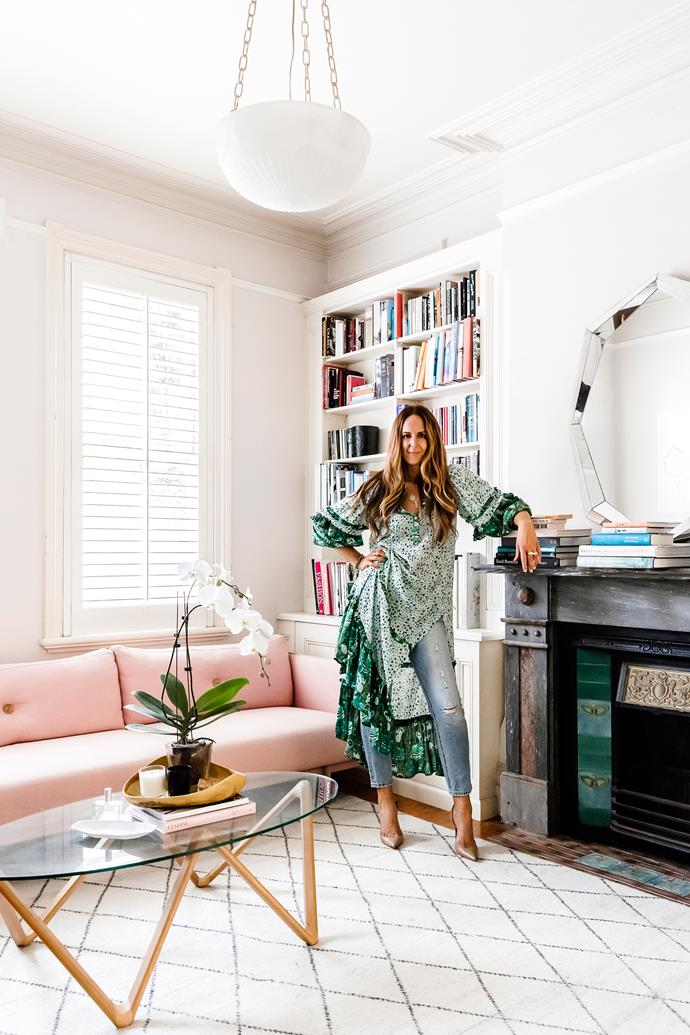 """The office/study is Tash's favourite room. """"The light and space are lovely – and I love that my kids can be on the sofa reading a book or doing their homework next to me while I work."""" Tash wears Spell & The Gypsy Collective dress, Levi's jeans and Christian Louboutin heels."""
