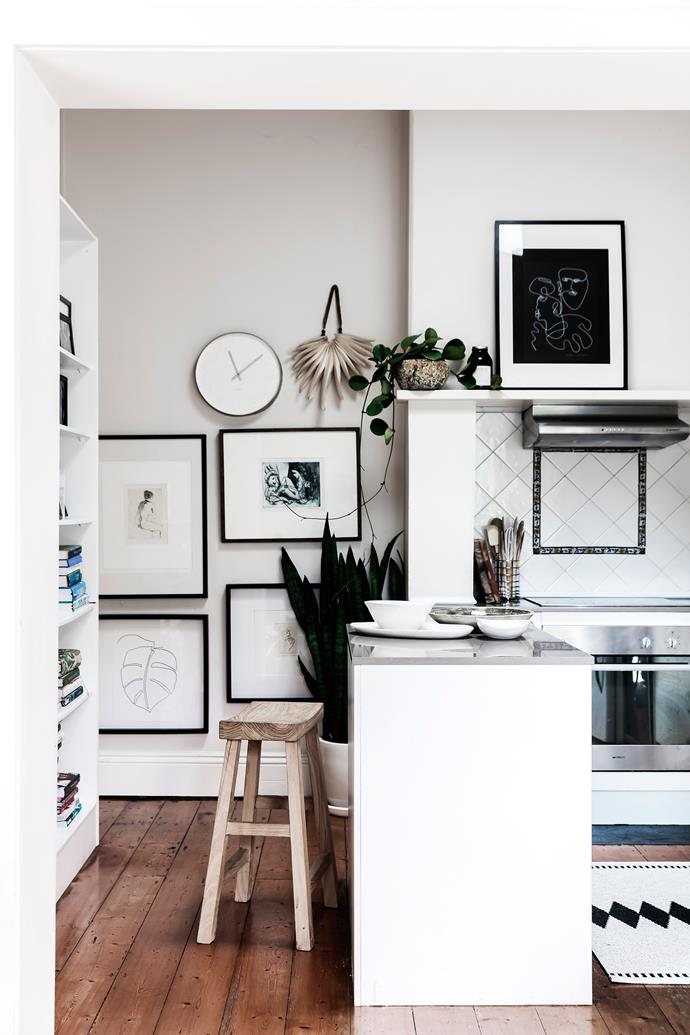 Some of Tash's artworks are displayed in her kitchen alongside art by Gary Shead, Lewis Miller and Louis Kahan. A rug from Nordic Fusion softens the timber floor.