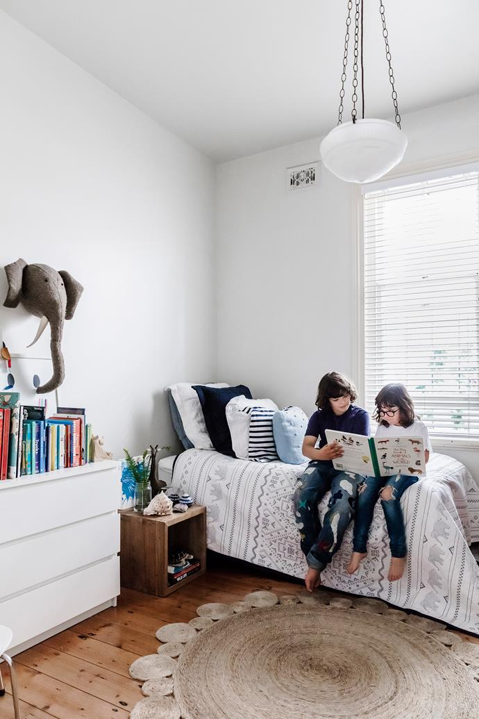"""Jay and Mac share their parents' love of books. """"We have books everywhere in the house,"""" Tash says. """"Stacked together, they create a story about us."""" She found the elephant bedspread at Anthropologie in New York. """"Mac likes elephants and it's a subtle way to have them in his room."""""""