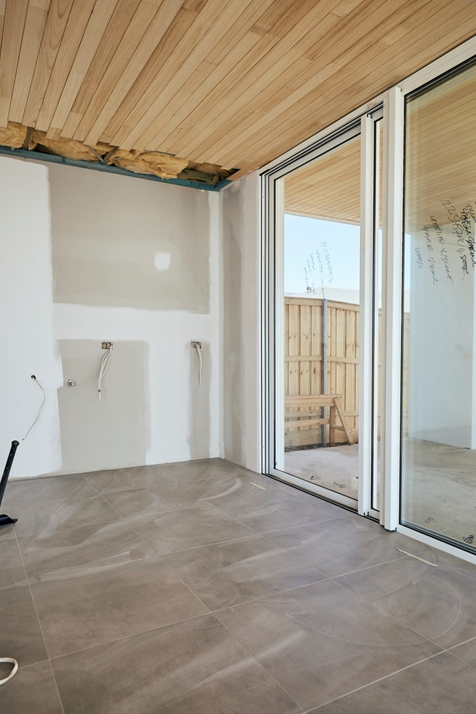 "**APRIL 15, 2018: FLOOR TILES LAID** <br><br> My Ideal House now has its floor tiles in. The 600x600mm grey porcelain tiles flow right through the ground floor's living areas. ""These concrete-look tiles will provide the perfect base for the house's interiors,"" says Tina Di Lorenzo, marketing manager for [Di Lorenzo Tiles](https://www.dilorenzo.com.au/