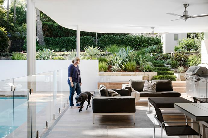 Prior to the renovation, the large backyard was little more than a sloped lawn. Now landscaped by Head Outdoors Landscapes, and with a pool and comfy seating added, it's a true extension of the living spaces. The timber-look tiles used in the open-plan area extend into this zone, with a slightly rougher surface for additional slip-resistance. All the furniture is from Harbour Outdoor.