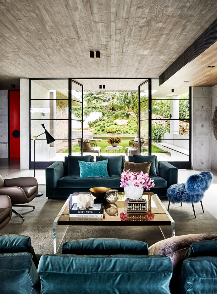 In the main living area, Minotti 'Andersen' sofas and Tom Dixon 'Beat' floor lamp from De De Ce. Ombre silk rug from Tibet Sydney. Baxter 'Nepal' chair from Criteria. Cushions from Tigger Hall Design and Seneca Textiles.