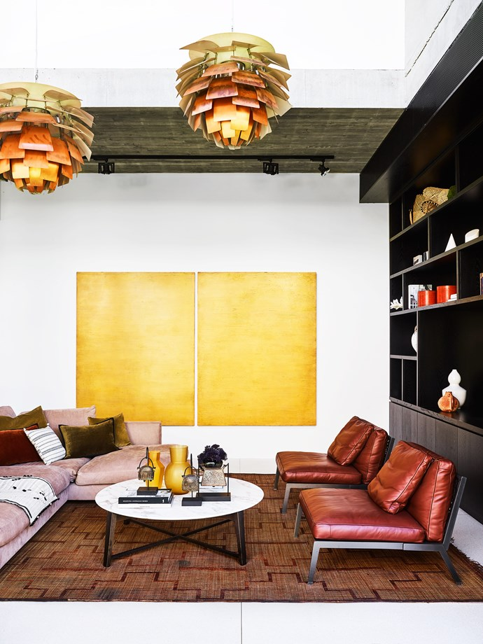 'Artichoke' lights in the informal sitting area were a vintage find. Flexform 'Happy' leather armchairs from Fanuli. Gervasoni sofa from Anibou. Coffee table from Pure Interiors. Tuareg mat from Kulchi. Cushions from Seneca Textiles. Artwork by Chris Cox.