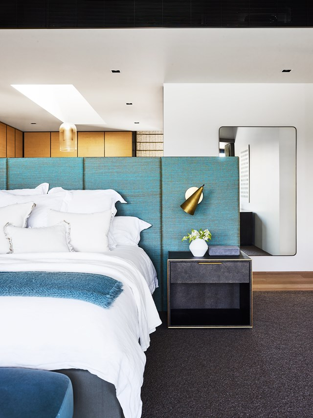 "Rich textures and pops of colour add warmth, interest and a touch of luxe in the bedroom of this [Modernist style home](https://www.homestolove.com.au/a-modernist-home-with-a-maximalist-interior-6555 |target=""_blank""). The waterviews, resort-style bathroom and turquoise tiled steam room really add to the hotel feel. Photo: Anson Smart / *Belle*"