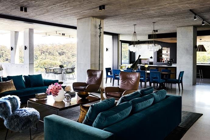 Minotti 'Andersen' sofas and Tom Dixon 'Beat' floor lamp from De De Ce. Baxter 'Nepal' chair in blue from Criteria. Sculpture by Dario Goldaniga. Christian Liaigre dining table and Velin dining chairs from Christian Liaigre, London