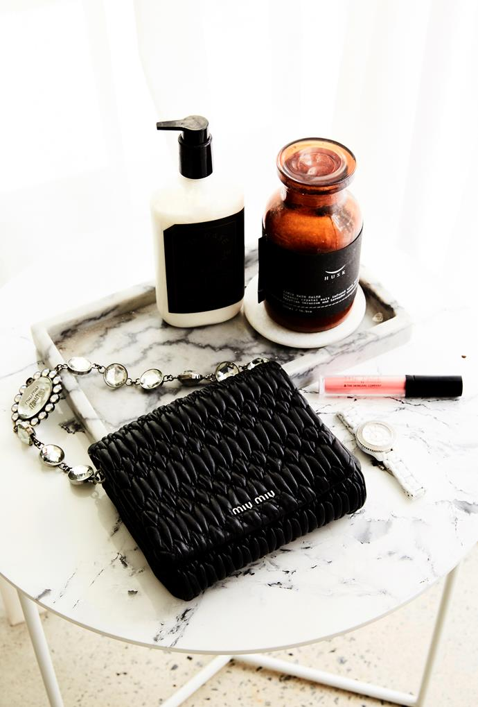 Bec's styling themes continue in her bathroom, with a marble tray displaying pretty but practical items, including a Miu Miu purse.